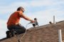 How Roofing Contractors Reshingle Steep and High-Pitched Roofs
